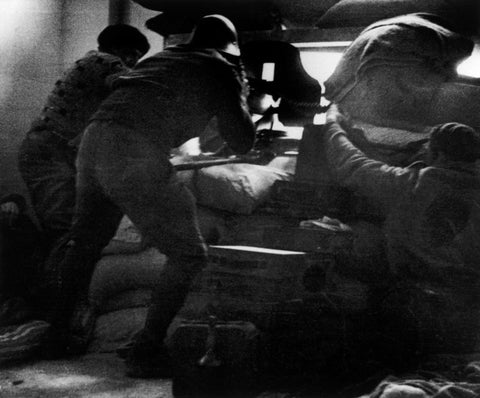 Robert Capa - Republican soldiers aiming machine guns through peepholes. University Residence, Madrid, 1936