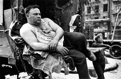 Henri Cartier-Bresson - New York laborer in back of truck in soiled vest 1947
