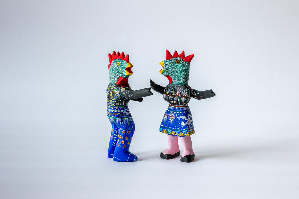 Dancing Chickens with black jumpers
