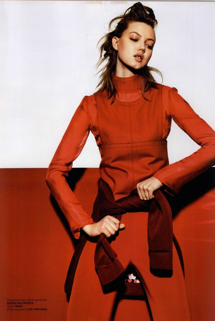 Model Lindsey Wixson wearing Begum Salihoglu Couture red top and pants on VOGUE magazine. Styled by Konca Aykan