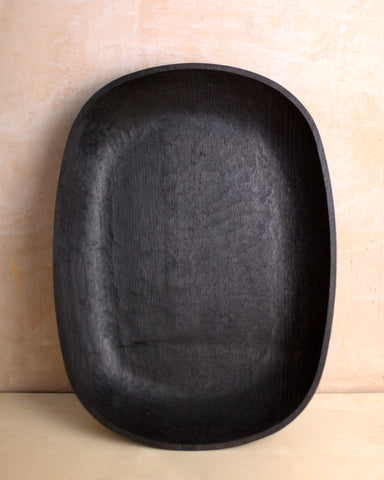 Large hand carved ebonised chestnut bowl