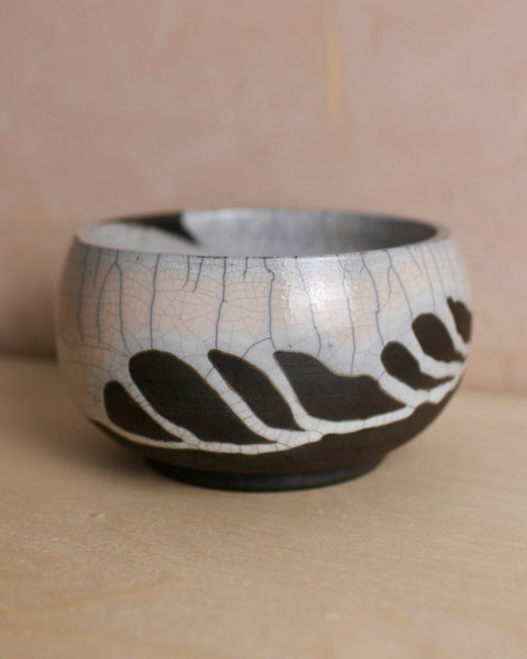 Medium white and black Raku bowl