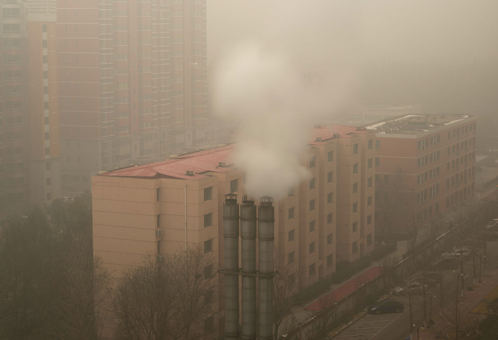A fast fashion production factory in China emits carbon dioxide, polluting the air.