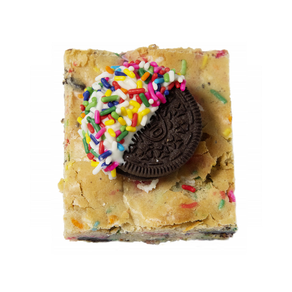 Blonde bar with sprinkles, oreo cookie dipped in white chocolate with sprinkles