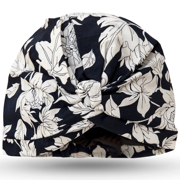 Dramatic ivory flowers on deep blue cotton stretch satin pull on waterproof turban, with pretty and gather and knotted at front.