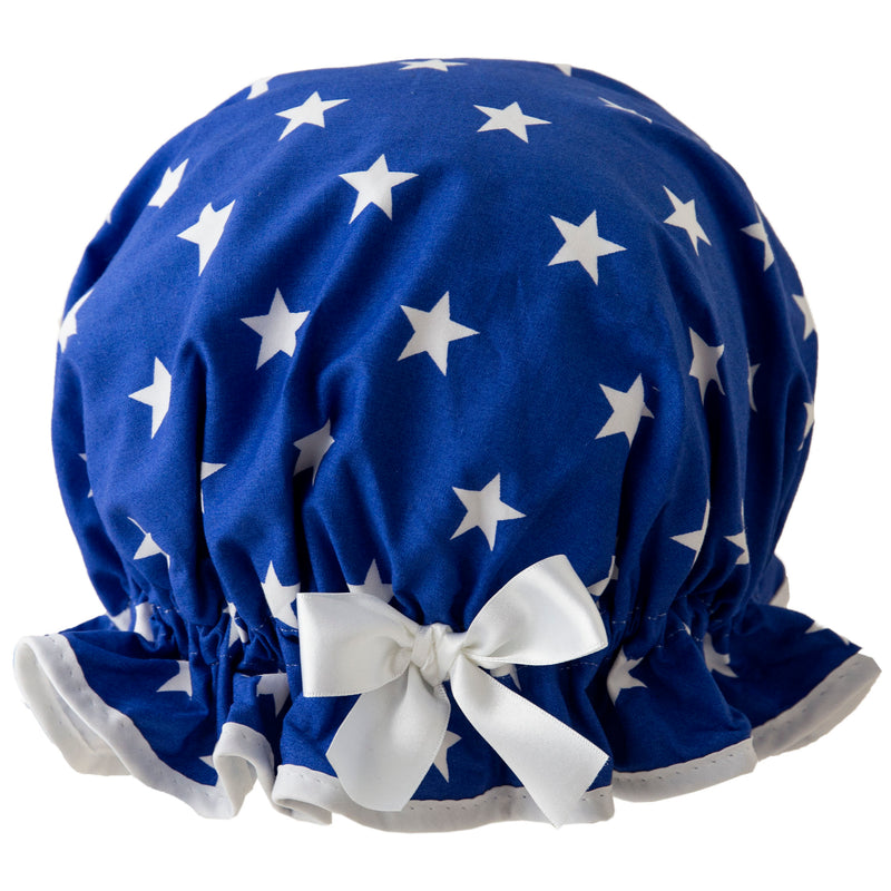 Vintage style, women's large cotton shower cap. Frilled edge, white stars on royal blue background. Trimmed in white with matching satin bow.
