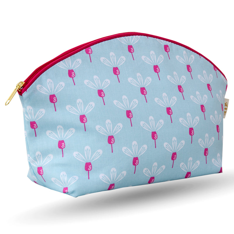 Curved zip top cotton sponge bag.  Pink and white flowers on a sky blue background. Trimmed in cerise with matching zip.