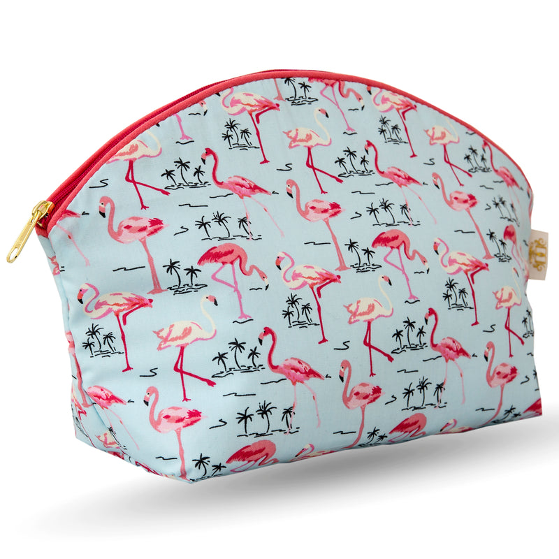 Curved zip top cotton sponge bag.  Pink flamingos with small black palm tree outline on pale blue background.  Trimmed in salmon pink with cerise zip.