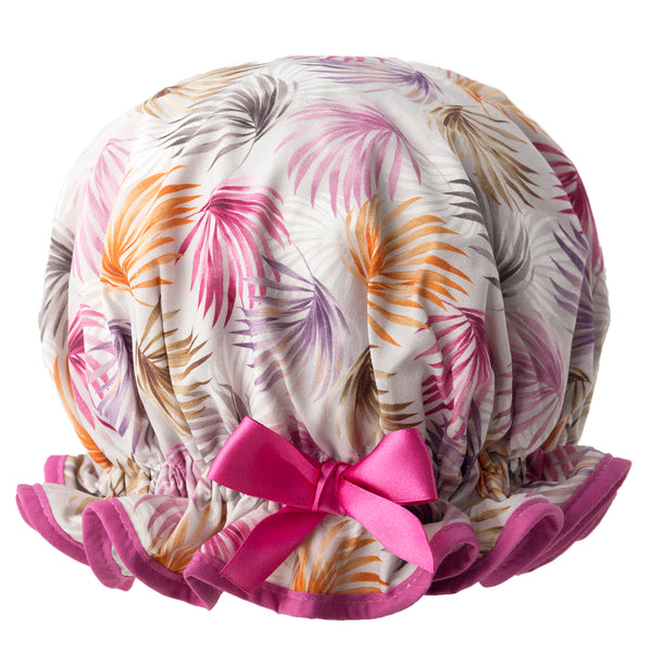 Vintage style, women's large cotton shower cap. Frilled edge, multicoloured leaf print in purple, brown and greys. Trimmed in purple with matching satin bow.
