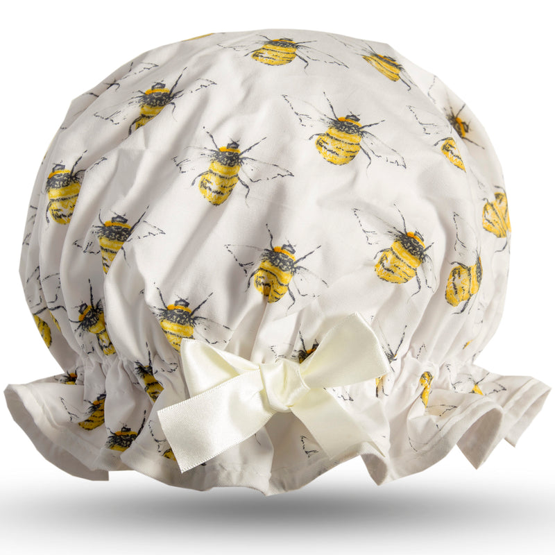 Vintage style women's large cotton shower cap.  Frilled edge, symmetric bee print on ivory background with ivory trim and bow.