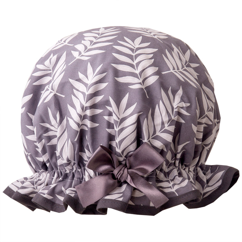 Vintage style, women's large cotton shower cap. Frilled edge, pale grey fern print on charcoal grey background with dark grey trim and satin bow.