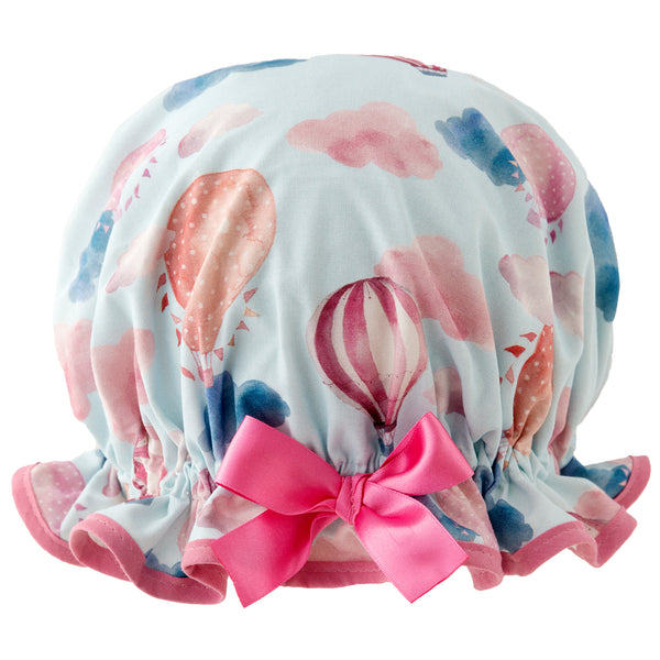 Vintage style, women's large cotton shower cap. Frilled edge, pale blue background with fun pink hot air balloon and cloud print. Trimmed in pink cotton and matching satin bow.