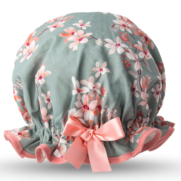 Vintage style, women's large cotton shower cap.  Frilled edge, with peach and cream trailing flowers on a flinty grey green background.  Trimmed in peach with matching satin bow.