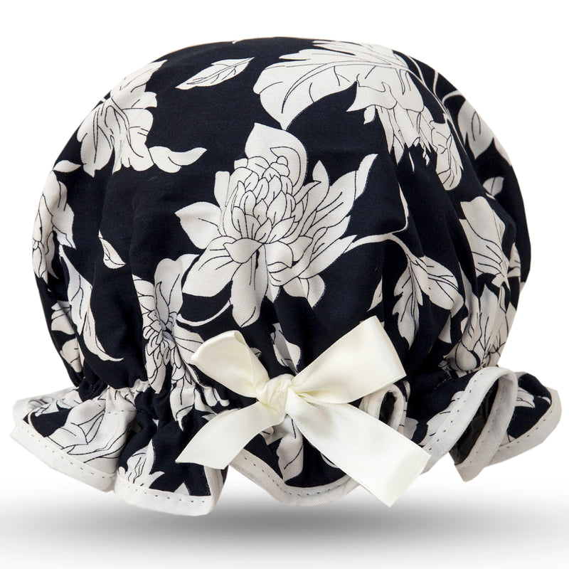 Vintage style, women's large cotton stretch satin shower cap. Frilled edge, white floral print on deep blue background with ivory trim and matching satin bow.