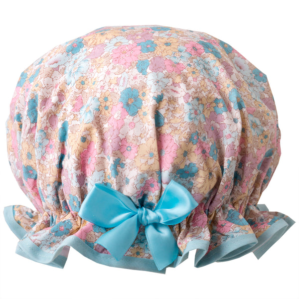 Vintage liberty style, women's large cotton shower cap. Frilled edge, pale pink, blue and cream flower print with aqua trim and matching satin bow.