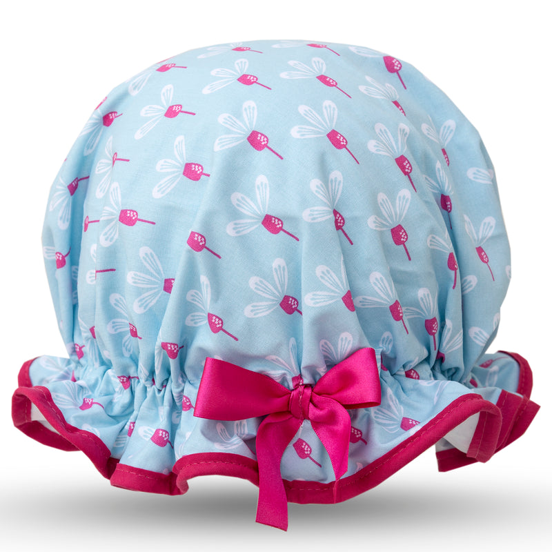 Vintage style women's large cotton shower cap.  Frilled edge, pink and white flowers on a sky blue background, cerise trim and bow