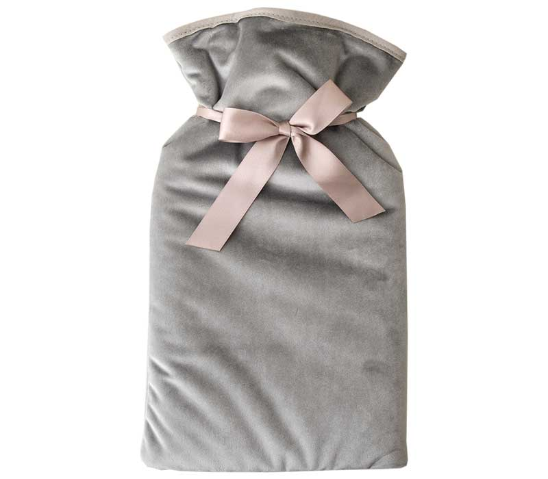 Silver velour hot water bottle cover.  Grey trim and ribbon bow.  2 litre cream hot water bottle included.