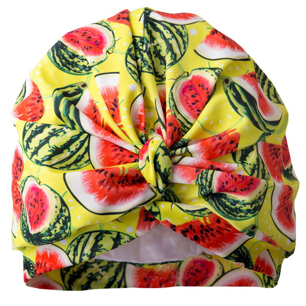 Yellow, green and red watermelon print lycra pull on waterproof turban, with pretty gather and knotted at front.