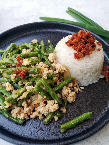 Chicken and green bean stir fry served with coconut pandan sticky rice