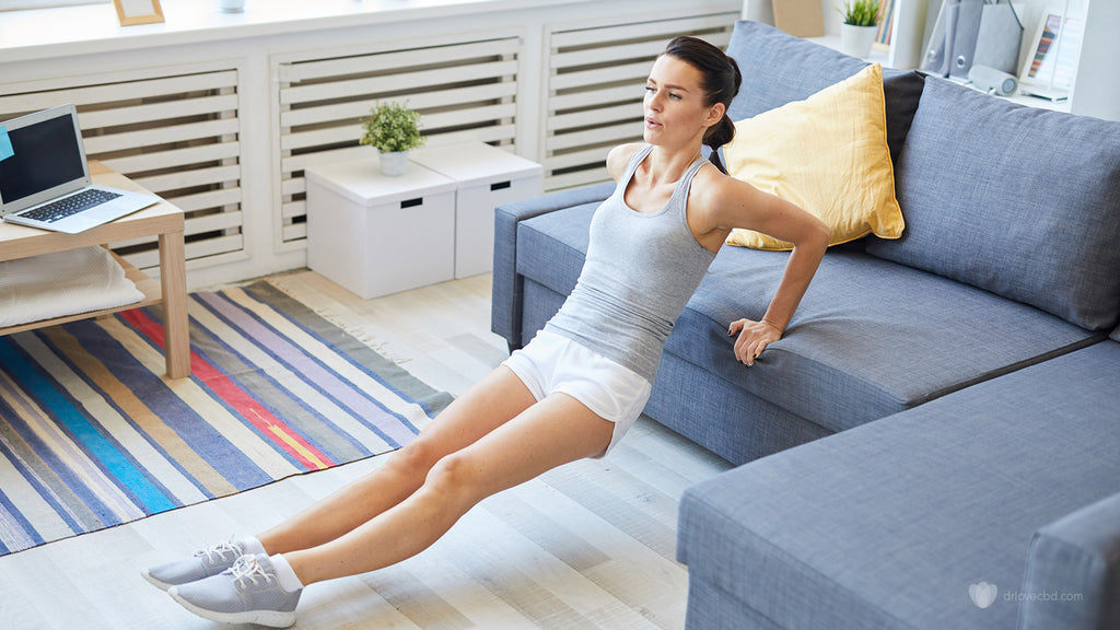 healthy woman inside at home workout stretching physical fitness plan