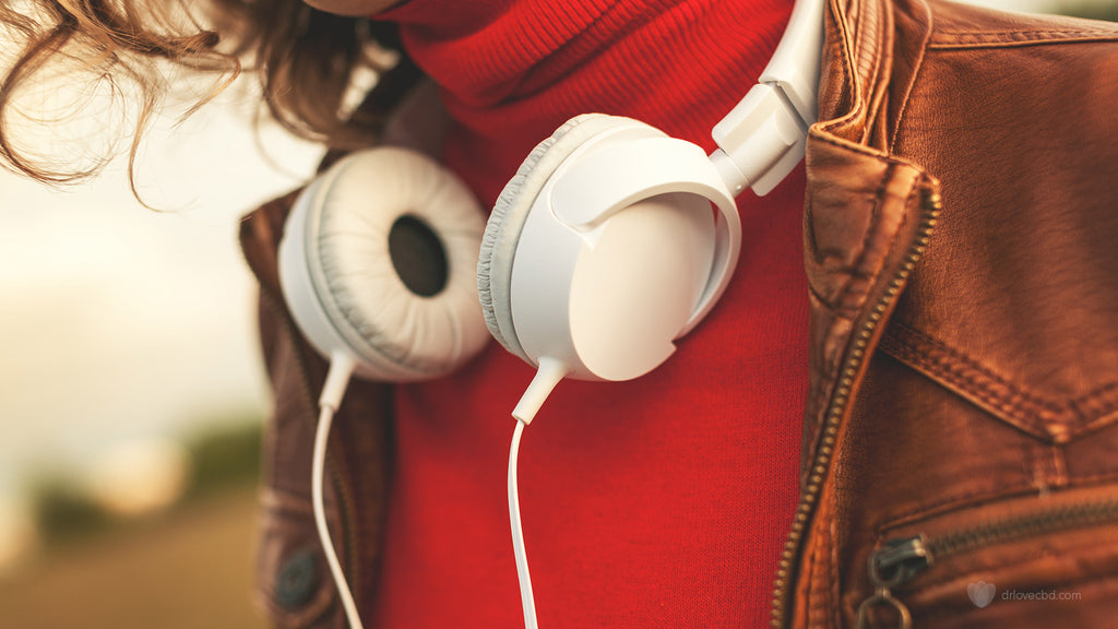 closeup of positive person feeling happy bright colors and headphones