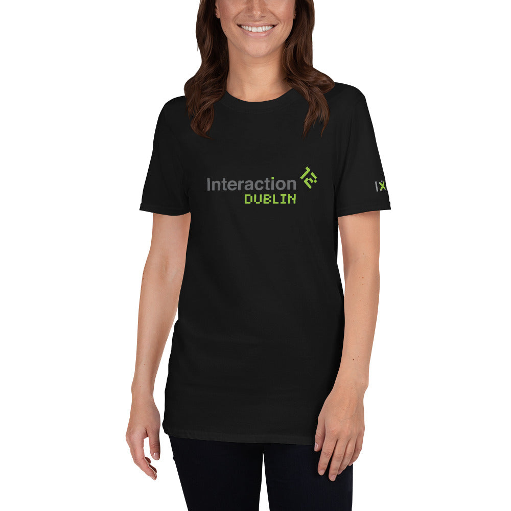 Woman in black T-shirt with grey and  green IxDA logo on the right sleeve