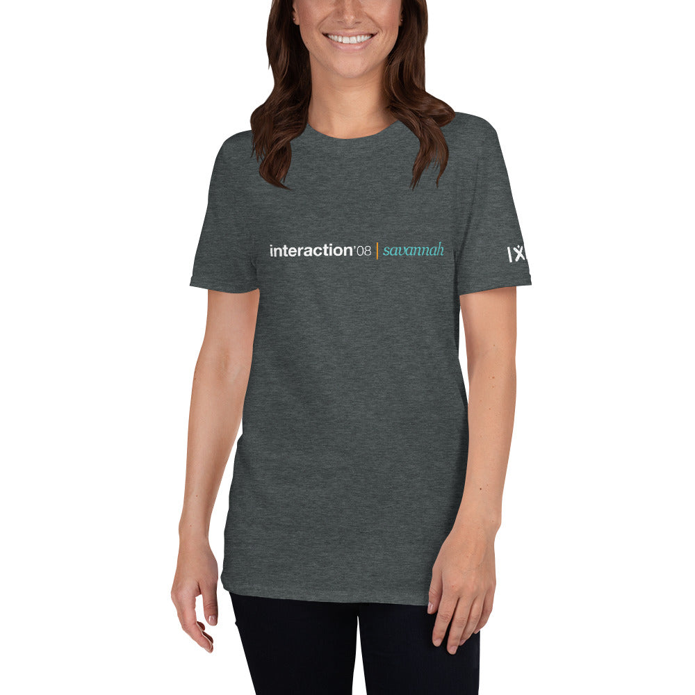 Dark grey T-shirt with white and teal Interaction 08 logo on front and white IxDA logo on right sleeve