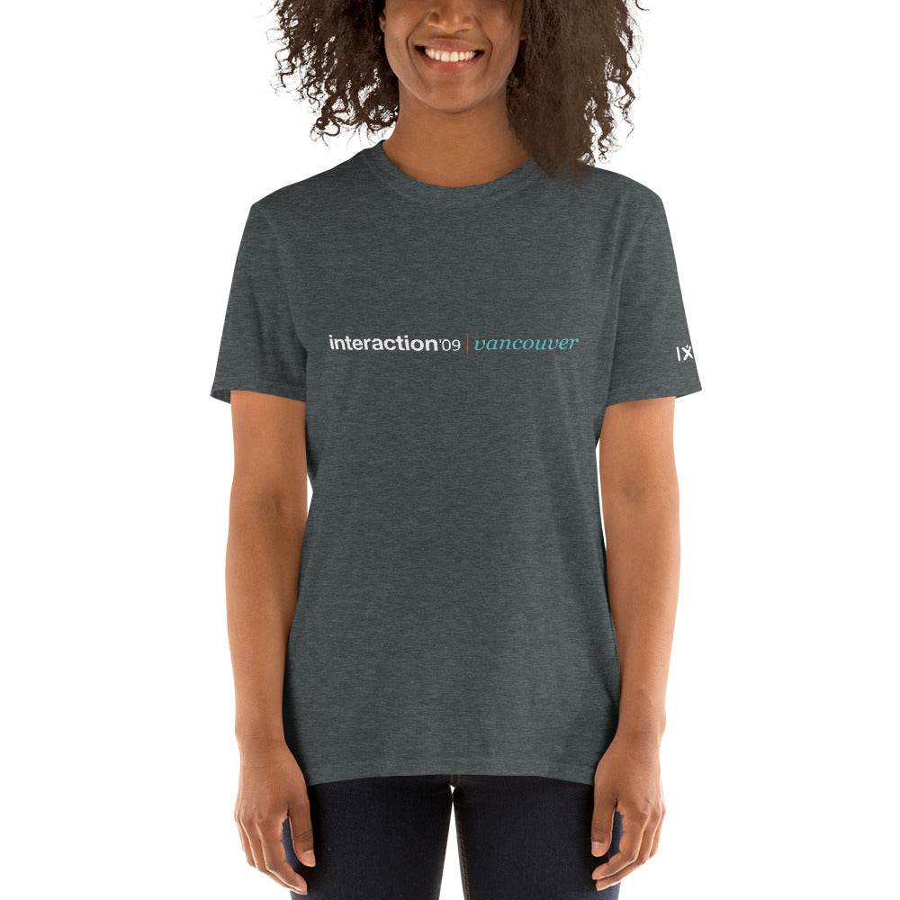 Dark grey T-shirt with white and teal Interaction 09 logo on front and white IxDA logo on right sleeve