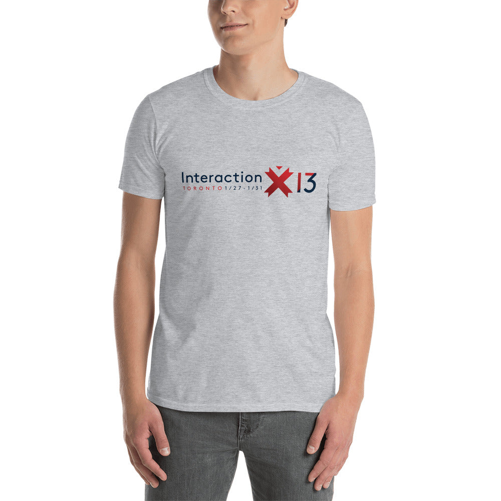 Man in sport grey T-shirt with red and blue Interaction 13 logo across the chest