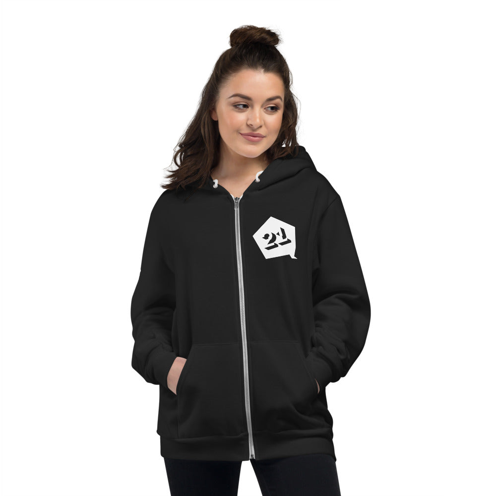 Woman wearing black zippered hoodie with white Interaction 21 graphic on left front.