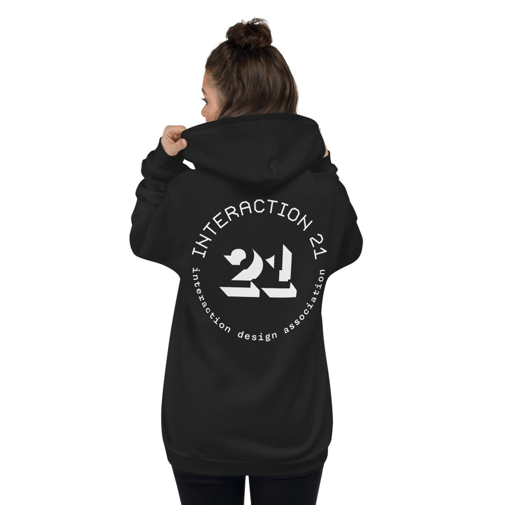 Woman wearing black zippered hoodie from the back with white Interaction 21 graphic across the back.