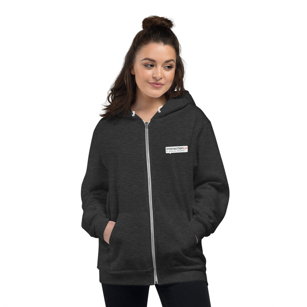 Woman in dark heather grey hoodie with Interaction 14 logo on left front