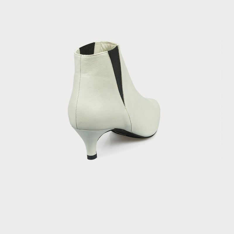 white leather boot with a kitten heel back view