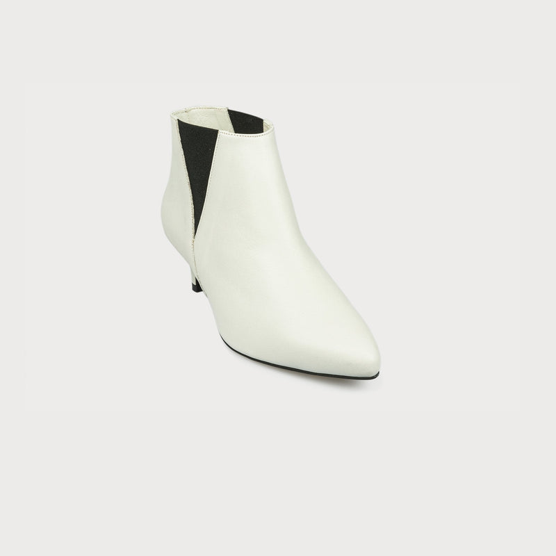 white leather boot with a heel front view