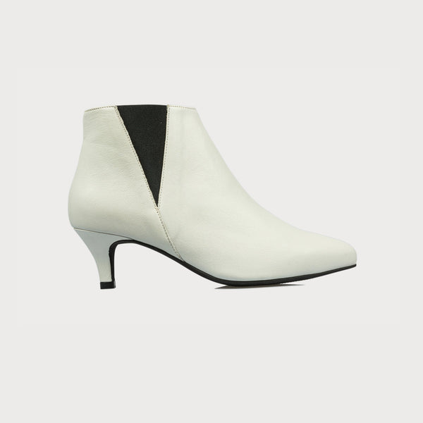 white leather boot with a heel side view