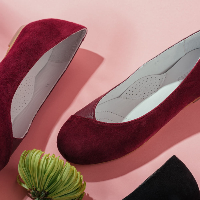 plum flat shoes close up