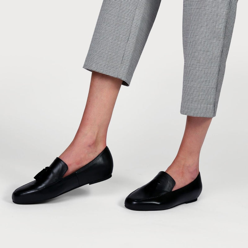 black leather loafers worn with checked trousers