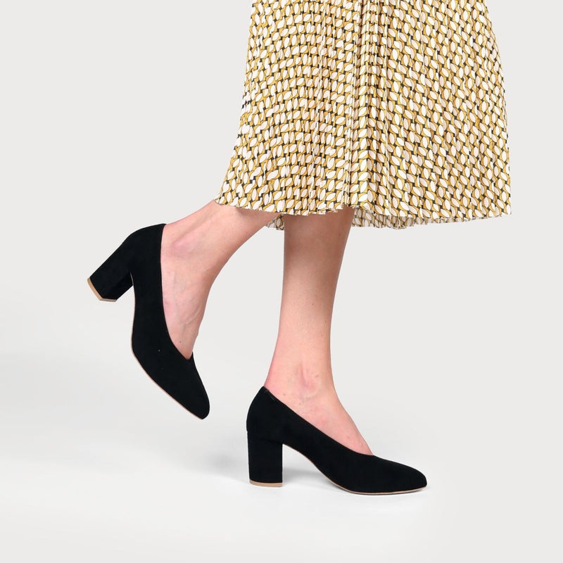 black suede heeled dress shoes on feet