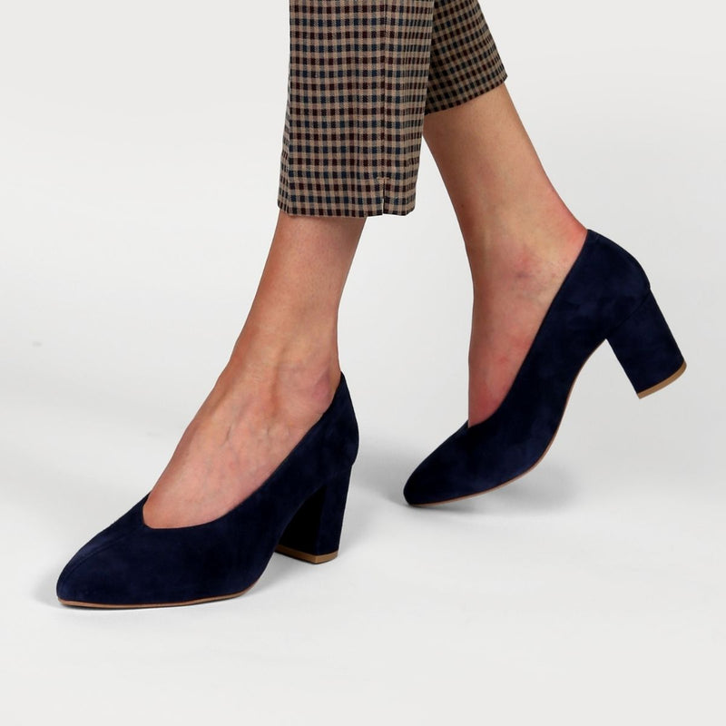 navy suede block heel shoe on feet