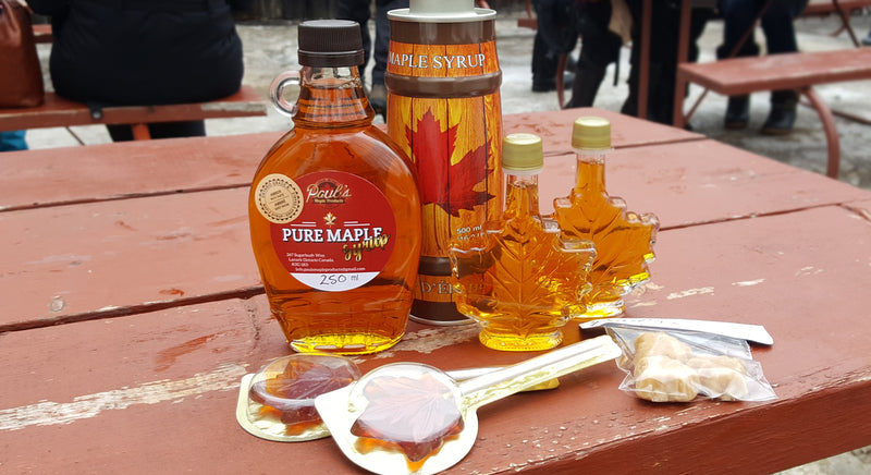 bottles of maple syrup and candy