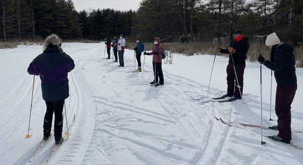 skiers in a line for a lesson