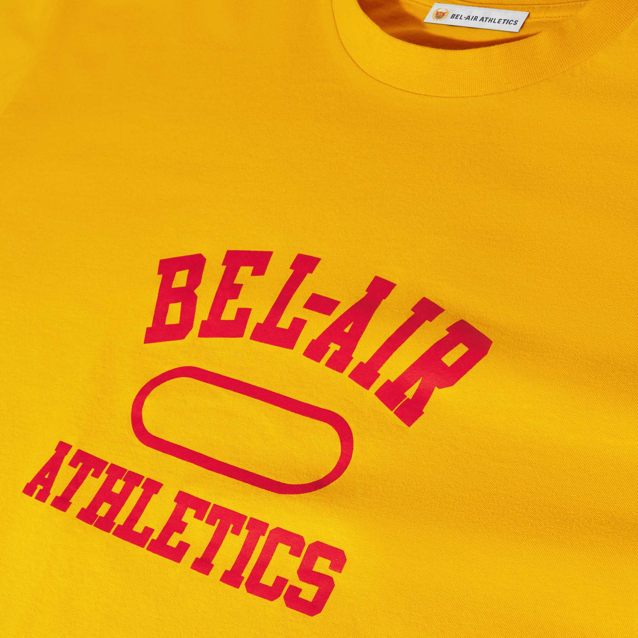 Gym Logo LS T-Shirt - Collegiate Gold with Academy Red print