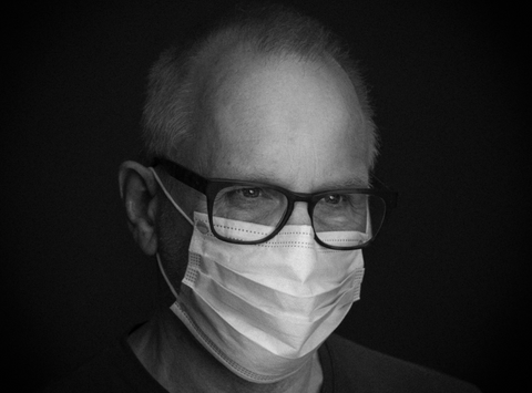man wearing face mask with glasses