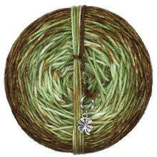 Load image into Gallery viewer, Avocado Toast is a double dyed cake of yarn with an avocado green as it's base and caked dyed with brown to give a final ombre gradient. A clover stitch marker is included with each cake!