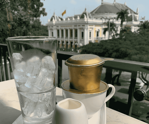 Vietnamese Coffee Phin Brewing with view of Hanoi Opera House