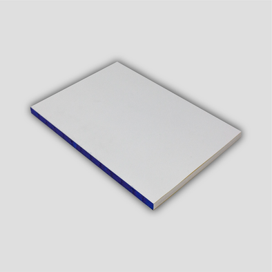 Diagonal photograph of the Hanaduri Edge notebook, A5 sized, showcasing blue-painted spine