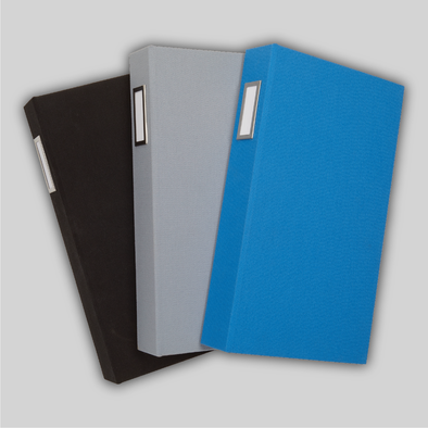 Fanned array of three ProFolio Photo Album Deluxes in blue, gray, and black