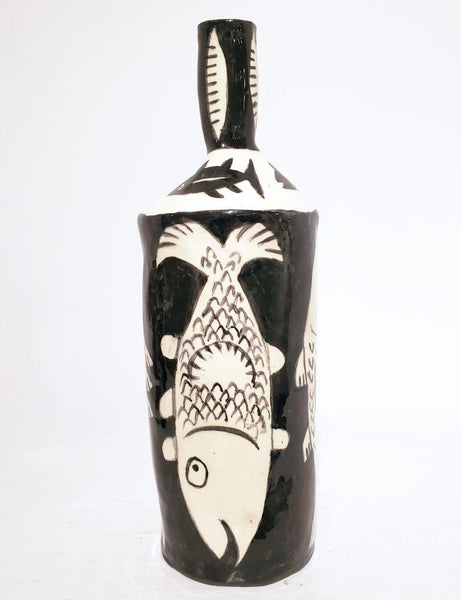 Tall Bottle, Four Fishes