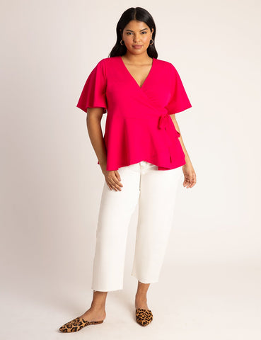 Flutter Sleeve Peplum Wrap Top in Love Potion