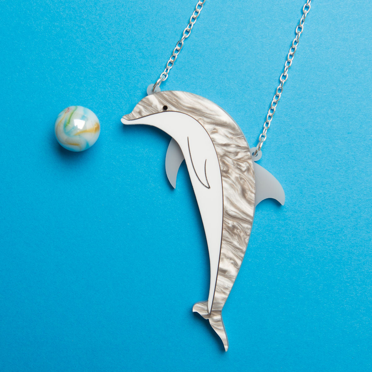 Sugar & Vice Dolphin necklace social media